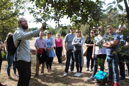 Jason Irving discussing the identification of a crab apple tree and the uses of the fruit on a London foraging course